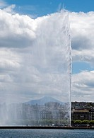 Jet d´Eau fountain on Geneva Lake in Geneva, Switzerland, one person under the fountain shows the size of it