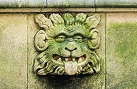 Gargoyle on bench in Dean's Park in the grounds of York Minster cathedral, York, England, United Kingdom