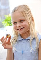 Young girl eating a donut