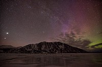 Aurora borealis dances over sheep mountain which is in kluane national park, yukon canada