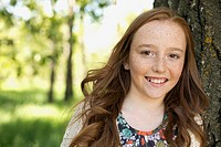 Portrait of pretty, redhaired middle school student outside