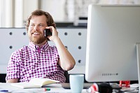 Smiling, creative professional having phone conversation