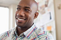Portrait of handsome, African American businessman at office