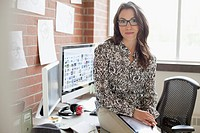 Pretty, female, industrial designer working in office