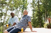Men enjoying beverages on an outdoor deck