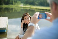 Middle_aged man taking picture of pretty wife
