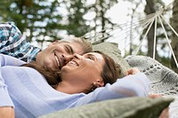 Couple relaxing in hammock together