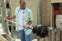 African_American man doing chores on rural property