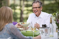 Middle_aged couple enjoying a meal outdoors