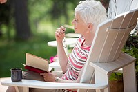 Middle_aged woman gazing off from adirondack chair