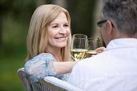 Middle_age couple toasting with wine outdoors