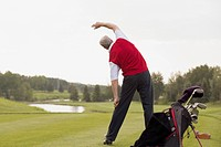 Middle_aged man stretching before golf game