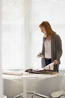 Woman looking at samples of wallpaper (thumbnail)