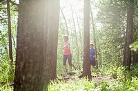 Couple running on trail through the woods (thumbnail)