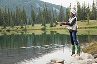 African American woman enjoying some fishing on the lake
