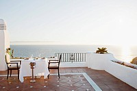 Outdoor restaurant on rooftop by sea