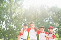 Four members of boys baseball team standing together (thumbnail)