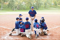 Coach talking with his boys baseball team