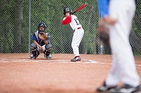 Young baseball player at home plate ready to bat