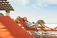 Woman relaxing on sunlounger
