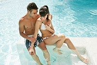 Couple bathing in swimming pool