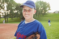 Portrait of preteen baseball player in uniform