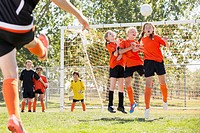 Young soccer player defending her net with a header