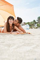 Young couple resting on beach (thumbnail)