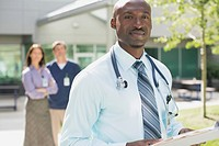 Portrait of African American doctor outdoors.