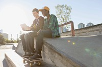 Teenage boys at skate_park with pc tablet