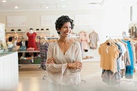 Pretty store owner in midst of clothing store (thumbnail)