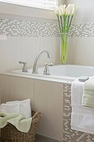 Details of modern tiled bathroom with calla lilies