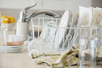 Modern white dishes drying in rack