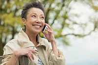 Asian woman having a conversation on cell phone outdoors