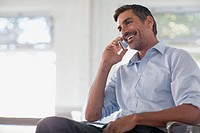 Middle_aged businessman on cell phone in office