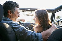 View from behind of couple in car