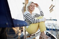 Senior woman sitting on sailboat