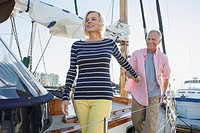 Senior couple walking on boat deck