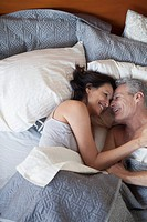 View from above of couple in bed