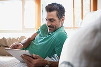 Middle_aged man browsing on pc tablet