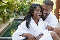 African American couple cudding at outdoor spa.