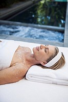 Middle_aged woman enjoying salt scrub treatment