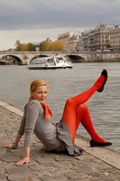 a beautiful woman in Paris, by the Seine