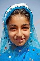 Portrait of nomad girl in traditional clothes, Iran