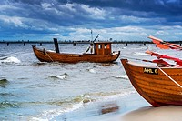 Two Fishing boats at the beach of the Baltic Sea, near the pier of the Baltic Sea resort of Ahlbeck, Municipality of Heringsdorf, Usedom Island, Count...