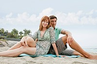 Couple sitting on beach