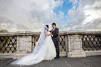 Newlyweds at Castel Sant'Angelo bridge Rome Italy