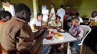 ETHIOPIA  The ´Salam Cafe´ in Chagni, Beni Shangul Gumuz region  Boys having breakfast of beans