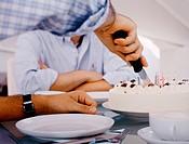 Man cutting birthday cake