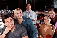 Friends Watching Sports Game at Bar